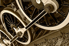 Sepia detail and close up of huge wheels at one old steam locomotive Stock Photo