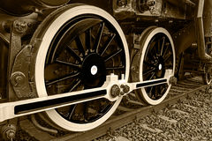Sepia detail and close up of huge wheels at one old steam locomotive Stock Photos