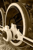 Sepia detail and close up of huge wheels at one old steam locomo Royalty Free Stock Photos