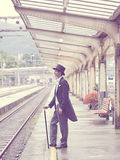 Sepia Effects Photo of Man in Black Tuxedo Standing on Train Station during Daytime Royalty Free Stock Photo