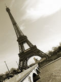 Sepia Eiffel Tower in Paris, France. Sepia photograph of the Eiffel Tower in Paris, with the Seine River in the foreground Stock Images