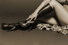Sepia female legs Royalty Free Stock Photos