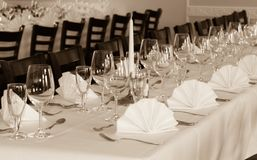SEPIA - Festive table arrangement with glasses and served and cutlery Royalty Free Stock Image