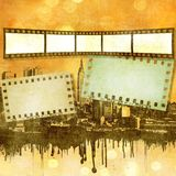 Sepia film strip background on dripping city skyline Royalty Free Stock Photography