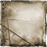 Sepia Film Strip Grunge Background. Sepia toned textured grunge background with filmstrips Royalty Free Stock Photo