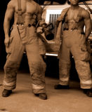 Sepia fire fighters. Two fire fighters buff sepia males Stock Images