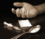 Sepia heroin. Human hand with cooked heroin and syringe Royalty Free Stock Images