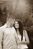 Sepia image of a couple looking at each other. Sepia toned image of a couple looking at each other with love Stock Photography