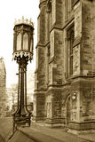Sepia lamp and gothic building. Sepia detail of lamp and ancient building in Glasgow Scotland UK Royalty Free Stock Image