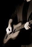 Sepia man and guitar Stock Photo