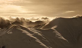 Sepia mountains in mist at sun evening Royalty Free Stock Photo