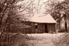 Sepia Old House. Sepia tone old house in the snow Stock Photos
