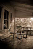 Sepia Old Time Country Porch. Sepia toned old time country porch with rocking chair and bench Royalty Free Stock Photography