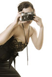 Sepia photograph. Retro photograph woman taking picture (colored sepia Stock Photography