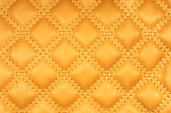 Sepia picture of genuine leather upholstery. Orange colour Royalty Free Stock Images