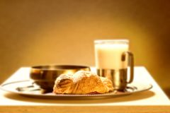 Sepia picture of a healthy breakfast (focus on croissante) Royalty Free Stock Photography
