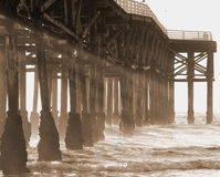 Sepia pier with sunrays Stock Photos
