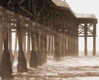 Sepia pier with sunrays Stock Photos