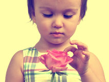 Sepia portrait of cute little girl with rose Royalty Free Stock Images