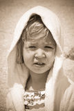 Sepia portrait of a little girl with towel on the head Stock Image