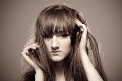 Sepia portrait of young beautiful woman Royalty Free Stock Image