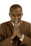 Sepia - Prayerful Man Stock Photo
