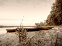 Sepia retro style, boat in pond Stock Photos
