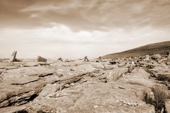Sepia rocks in hilly rocky burren landscape Stock Images