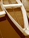Sepia Rowboats in Maine. Three sepia tone rowboats in the water  in Maine Royalty Free Stock Photos