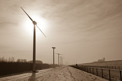 Sepia scenery of Windmills in a snowy landscape Royalty Free Stock Photos