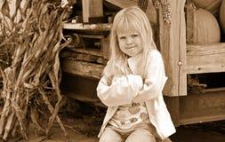 little girl on a pumpkin with attitude Stock Photos