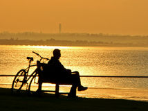 Sepia silhouette sunset cyclist Stock Images