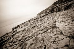 Sepia stone coastline Royalty Free Stock Photography