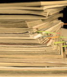 Sepia-style photo of pile of old magazines with bookmarks Royalty Free Stock Image