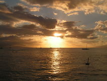 The Sepia Sunset. This is a nice and colorful (mainly gold) picture of a sunset and ships in the open sea. I took it  in Maui, Hawaii Stock Photo