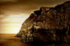 Sepia Tinted Cliff Ruins Stock Photography
