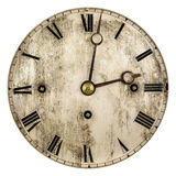 Sepia tonade bild av en gammal klockaframsida arkivfoto