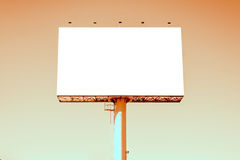 Sepia tone of blank billboard against blue sky for advertisement Royalty Free Stock Photography