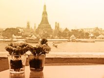 Sepia Tone Couple Vases of Flowers with Temple of Dawn in Background with Soft Focus Color Filtered used as Template Stock Image