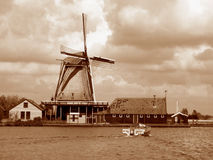 Sepia tone of Dutch Windmill on the Lake Shore of Zaanse Schans Royalty Free Stock Photo