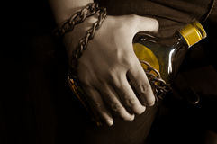Sepia tone filtered slave to alcohol concept. Stock Photography