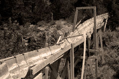 Sepia tone old mining sluice Royalty Free Stock Photo