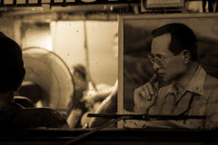 Sepia tone picture of King RAMA 9 Thailand (King Bhumibol Adulyadej) inside car. As beloved of us all. Royalty Free Stock Photography
