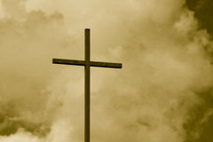 Sepia Toned Cross Sky. Sepia toned cross standing out against a cloudy sky Royalty Free Stock Images