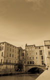 Sepia toned image Canal de la Robine through center of city with Stock Photography