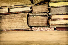 Sepia toned image of old books on a table Royalty Free Stock Photography