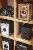 Sepia toned image of old box cameras and a binocular Royalty Free Stock Images