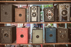 Sepia toned image of old box cameras Royalty Free Stock Photo