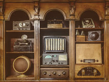 Sepia toned image of old radio`s. In a wooden cabinet Stock Photography