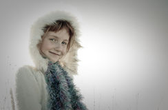 Sepia toned image of young girl haired girl wearing Eskimo styled fur trimmed hood Stock Photography